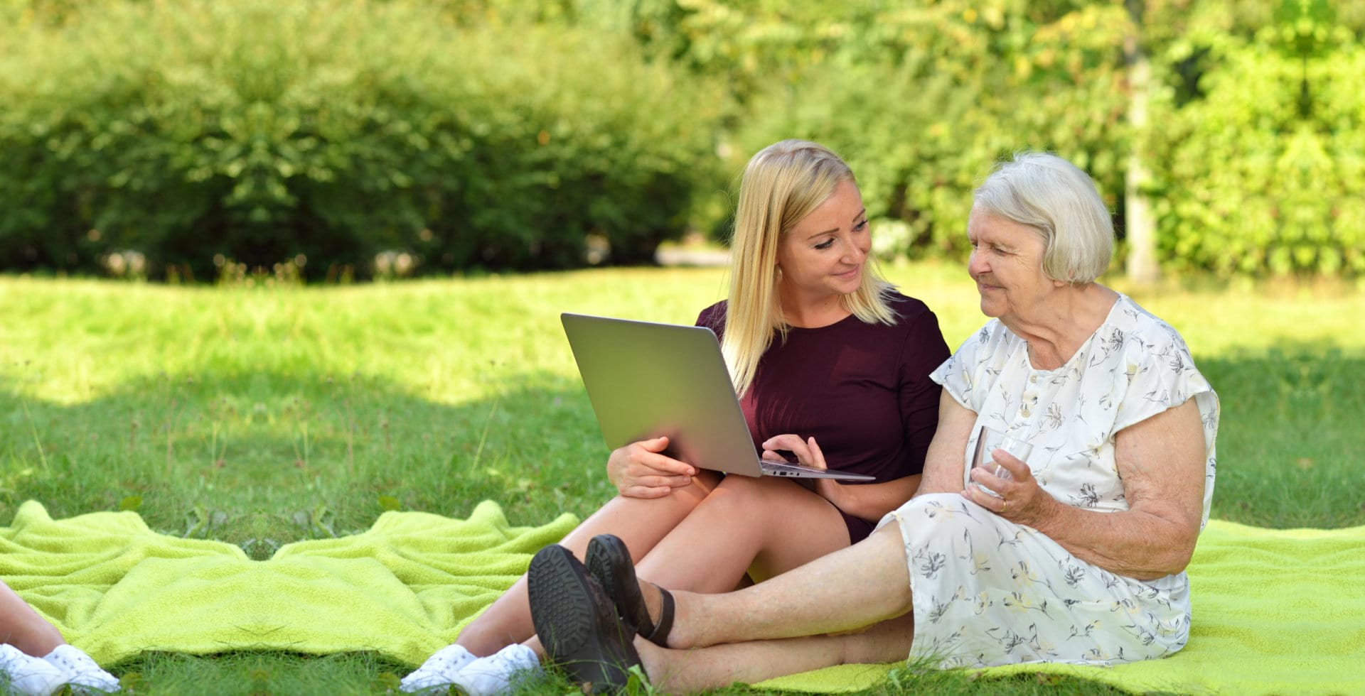 senior woman with her granddaughter using laptop